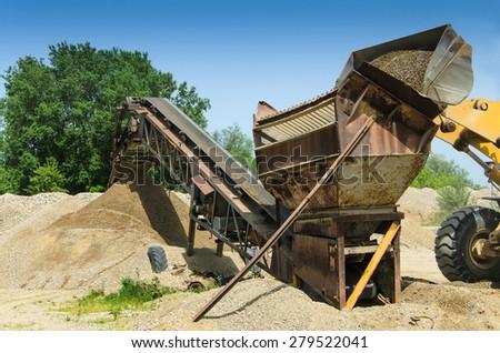 Gravel pit mining - stock photo