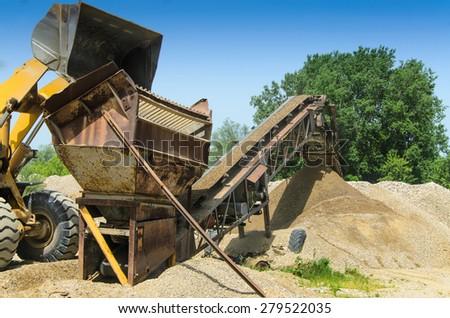 Gravel pit sieve - stock photo