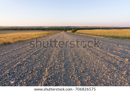 Gravel road at sunset in Saskatchewan, Canada.