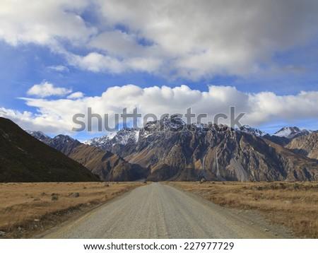 Gravel road leading to Tasman Valley in Aoraki Mount Cook National Park, Canterbury region, South Island, New Zealand. - stock photo