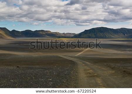 Gravel rurar road in the wilderness in Iceland - stock photo