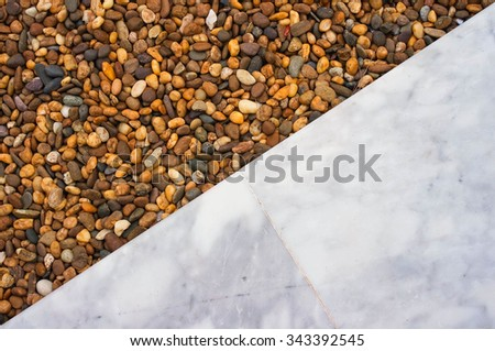 Gravel texture abstract background, Decorative floor pattern of small gravel stone and marble tiles - stock photo