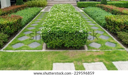 Gravel texture and strip grass in garden - stock photo