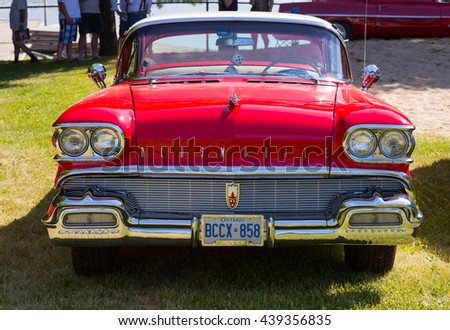 Gravenhurst, Ontario - June 18, 2016: Vintage Oldsmobile car in red color displayed during the annual Gravenhurst car show - stock photo