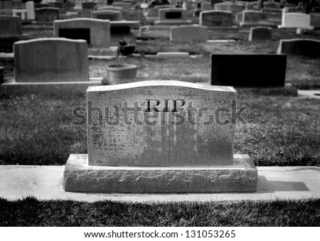Gravestone in cemetery with words RIP rest in peace carved - stock photo
