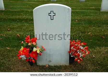 Gravestone with flowers - stock photo