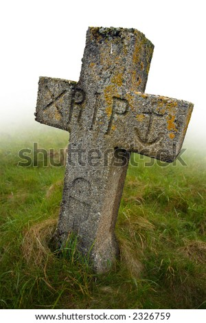 Gravestone with the initials RIP carved into it.  Ancient gravesite in South Uist, Scotland. - stock photo