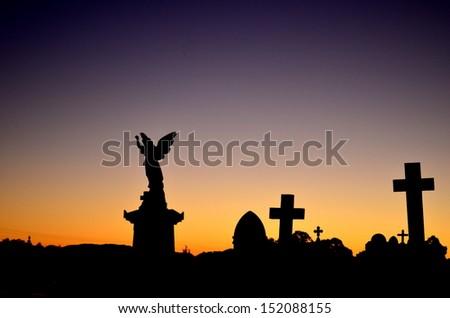 Graveyard at sunset - stock photo