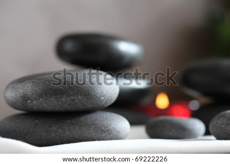 Gray and black stacked massage stones - stock photo