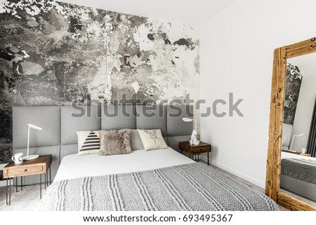 Gray And White Interior Of Modern Bedroom With Wooden Bedside Table, Big  Rustic Mirror And