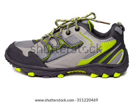 Gray and yellow classic styled sneakers on a white back ground. - stock photo