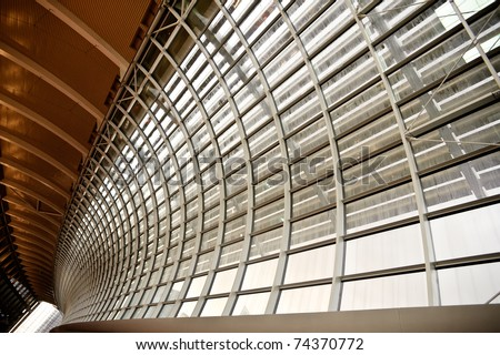 Gray and yellow unusual geometric ceiling and the channel of building. - stock photo