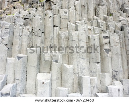 Gray basalt column formation rocks in Iceland - stock photo