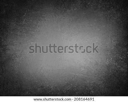 gray black background, old vintage paper texture design with worn and cracked black vignette grunge border, chalkboard background - stock photo