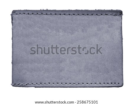 gray blank leather jeans label on white  background - stock photo