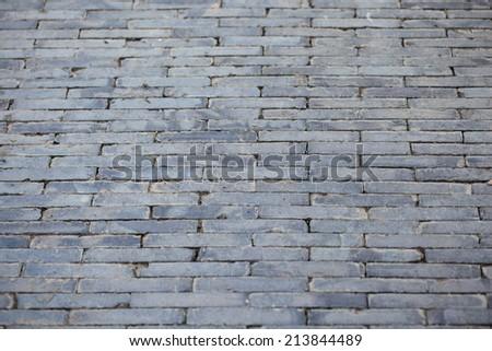 gray brick road  - stock photo