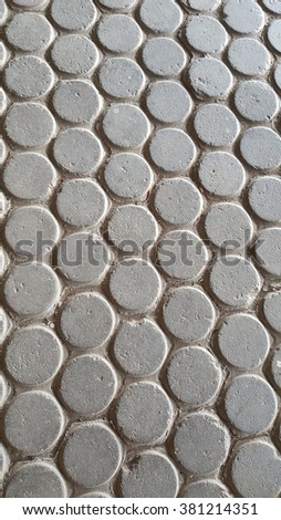 Gray bricks paving stones on a sidewalk - stock photo