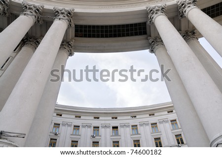 gray building in the city with large columns - stock photo