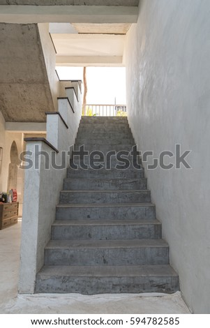 Elegant Gray Cement Stairs With Cement Railing