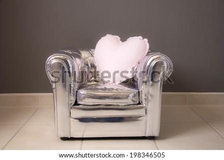 gray chair cushion design silver heart rhinestones - stock photo