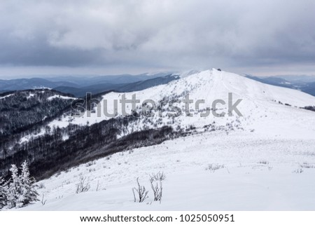 Gray clouds over the Bieszczady moutains summit