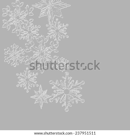 Gray colored Christmas background with textured snowflakes