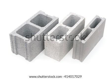 Gray concrete construction blocks isolated on white - stock photo