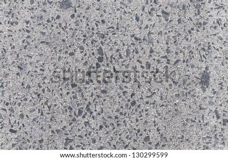 Gray concrete floor with dark stones background - stock photo