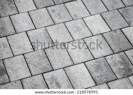 Gray concrete tiling, urban pavement, background texture - stock photo
