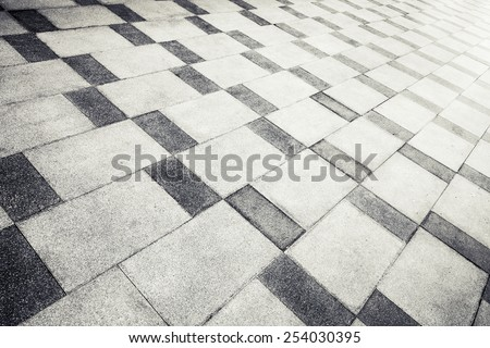 Gray concrete tiling with abstract pattern, urban pavement, background photo texture - stock photo
