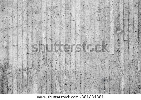 Gray concrete wall with relief pattern from timber formwork, background photo texture  - stock photo