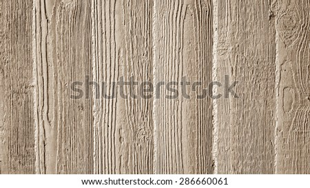 Gray concrete wall with wooden relief embossing, warm light - stock photo