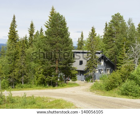 Gray cottage in the woods. Northern Finland - stock photo
