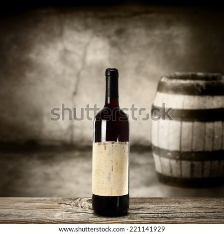 gray dark interior and bottle of wine and free space  - stock photo