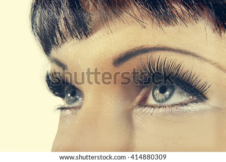 Gray eyes with artificial eyelashes. Retro style