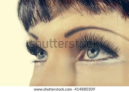 Gray eyes with artificial eyelashes. Retro style - stock photo