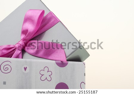 Gray gift box, isolated on white, with bow