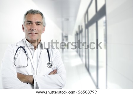gray hair expertise handsome senior doctor hospital portrait white corridor [Photo Illustration] - stock photo