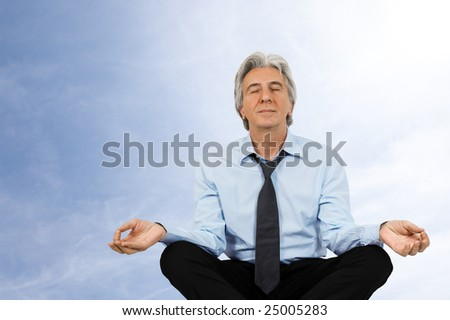 Gray-haired businessman relaxing. - stock photo