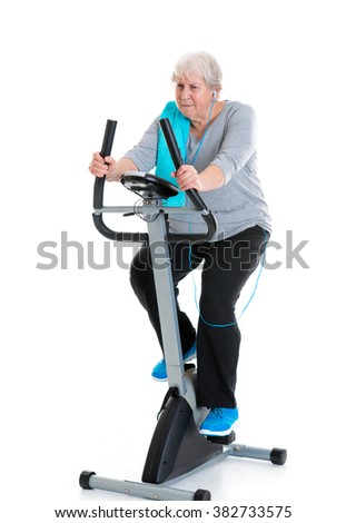 gray-haired female senior train with fitness machine