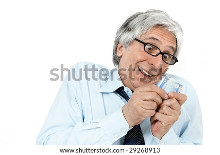 Gray-haired greedy businessman with banknotes in his hands