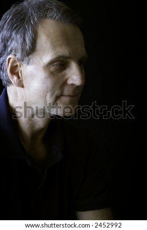 Gray haired man on black background