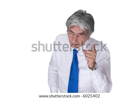 Gray-haired mature man wearing a white shirt and a blue necktie pointing his finger.