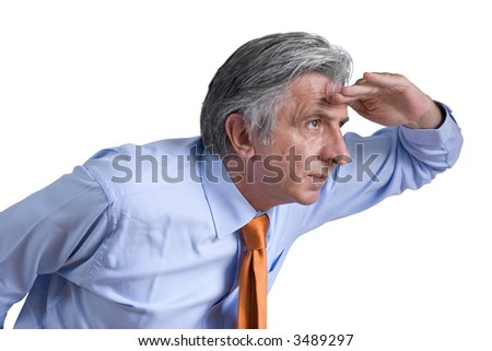 Gray-haired senior wearing an orange tie and a light blue shirt looking forward. - stock photo