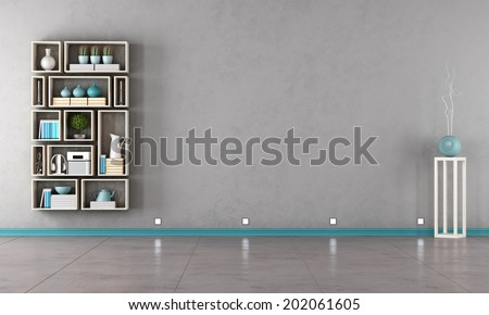 Gray interior with modern bookshelf on wall - rendering - stock photo