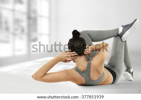 gray interior with window and young woman and sport time  - stock photo