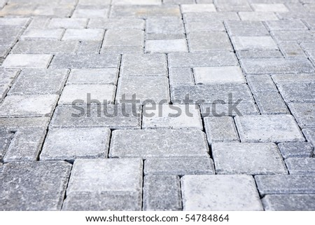 Gray interlocking paving stone driveway from above - stock photo