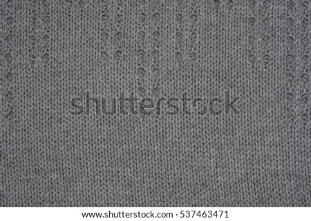 Gray knitted background.