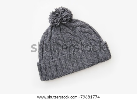 Gray knitted wool hat with Pom Pom isolated on white background - stock photo