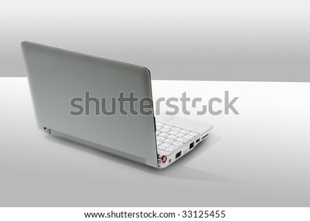 Gray laptop computer close up still with copy space in a white background - stock photo